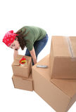 Woman Lifting Boxes Royalty Free Stock Images
