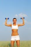 Woman lifting dumbbell Stock Photos