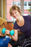 Woman lifting dumbbell stock images