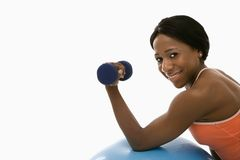 Woman lifting dumbbell. Stock Photo