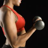 Woman lifting dumbbell. Royalty Free Stock Image