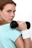 Woman lifting a dumbbell Royalty Free Stock Photo