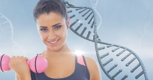 Woman lifting dumbbell against DNA structure stock images
