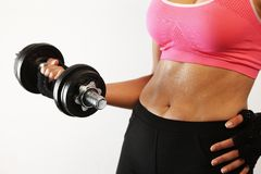 Fit woman lifting a dumbbell royalty free stock photo