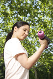 Woman lifting dumbbell Stock Image