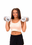 Woman lifting dumbbell's. Stock Photos