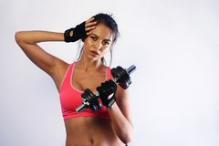 Woman lifting a dumbbell Stock Photo
