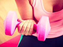 Woman lifting dumbbell. Young girl exercising in gym. Health workout fitness concept Royalty Free Stock Photography