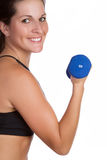 Woman Lifting Dumbbells Stock Images