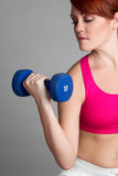 Woman Lifting Dumbbells Stock Image