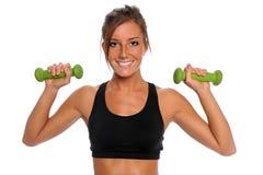 Woman Lifting Dumbbells Stock Image