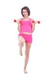 Woman lifting dumbbells Royalty Free Stock Photo
