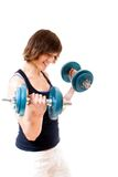 Woman lifting dumbbells Royalty Free Stock Image