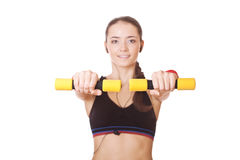 Woman lifting dumbbells - in focus only dumbbells Royalty Free Stock Photos