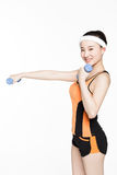 Woman lifting dumbbells Royalty Free Stock Photos
