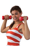 Woman lifting dumbbells Stock Photos