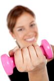 Woman lifting a free weight Royalty Free Stock Images