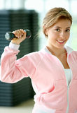 Woman lifting free weights Stock Photography