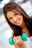 Woman lifting free weights Royalty Free Stock Image