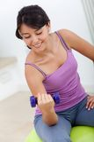 Woman lifting free weights Stock Photo