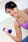 Woman lifting free weights Stock Images