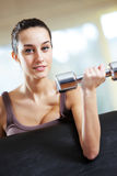 Woman lifting free weights Stock Photos