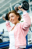 Woman lifting free weights Royalty Free Stock Images