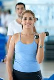 Woman lifting free weights Royalty Free Stock Photography