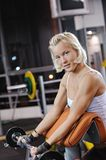 Woman lifting heavy weights Royalty Free Stock Image