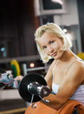 Woman lifting heavy weights Royalty Free Stock Photos