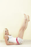 Woman lifting her legs Royalty Free Stock Photo