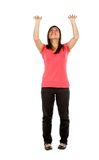 Woman lifting an imaginary object Royalty Free Stock Photo