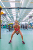 Woman lifting kettlebell in crossfit training Stock Photos