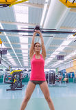 Woman lifting kettlebell in crossfit training Stock Photo