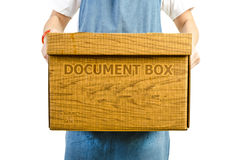 Woman lifting moving box. On white background Royalty Free Stock Image