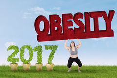 Woman lifting obesity word Stock Photo