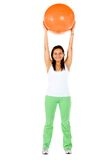 Woman lifting a pilates ball Stock Image