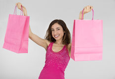 Woman lifting pink paper shopping bags Royalty Free Stock Photo