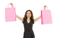 Woman lifting the pink shopping bags up Stock Image