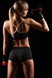 Woman lifting red dumbbell Stock Images