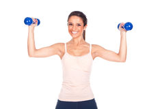 Woman lifting some weights and working out. Sporty woman lifting some weights and working out Royalty Free Stock Photo