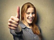 Woman lifting thumb Royalty Free Stock Photo