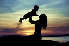 Woman lifting up her child Royalty Free Stock Photography