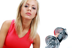 Woman lifting a weight Stock Photos
