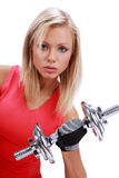 Woman lifting a weight. A photo of a woman lifting a weight Royalty Free Stock Image