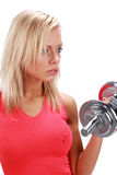 Woman lifting a weight Stock Image