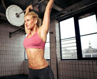 Woman Lifting Weight stock images