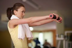 Woman lifting weight Royalty Free Stock Photography