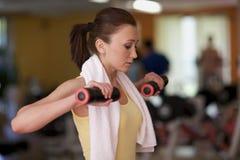 Woman lifting weight Stock Photo