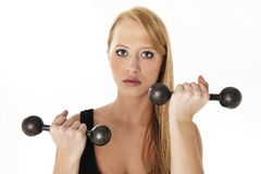 Woman lifting a weight. Beatiful blond women woman lifting a weight Royalty Free Stock Photo